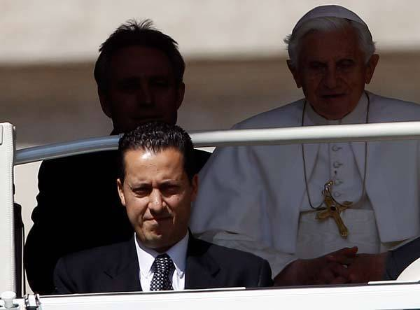 The Pope's butler, Paolo Gabriele (bottom L) arrives with Pope Benedict XVI (R) at St. Peter's Square in Vatican.