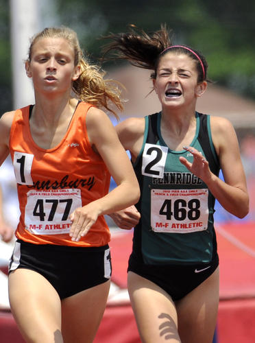 Marissa Sheva of Pennridge, right, struggles but loses to eventual winner Sara Sargent of Pennsbury, left, in AAA Girls 1600 Meter Run. Action is on day 2 of PIAA Track & Field Championships.