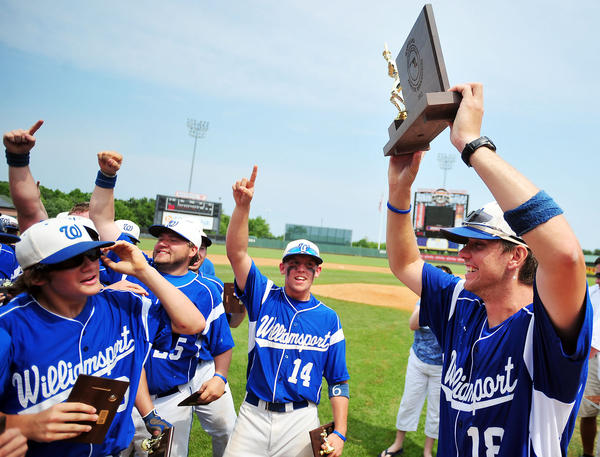 Williamsport coach David Warrenfeltz (18) holds up the Maryland Class 2A baseball championship trophy after a 2-1 victory over Patuxent in nine innings at Ripken Stadium in Aberdeen on Saturday.