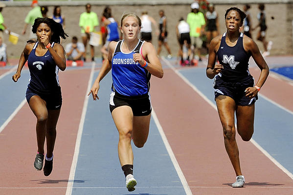 Boonsboro's Abby Duncan, center, beat Northwestern's Elizabeth Harper, left, and Manchester Valley's Erika Hurd, right, to the finish line to win the Class 1A girls 100-meter dash for the third straight year at the Maryland State Track & Field Championships at Morgan State University on Saturday. Duncan also won the 200 for the third straight year as the Warriors won the team title for a second straight season.