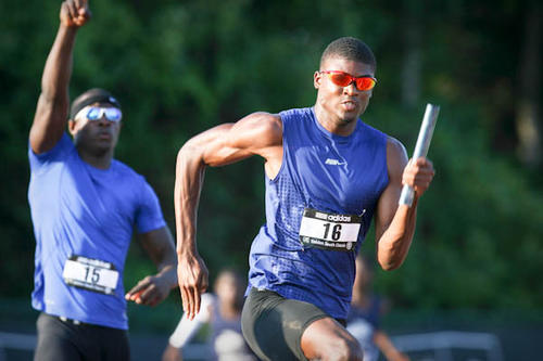 KJ Dillon (15), makes the hand off to Darius Fields (16) for Apopka high school as they compete in the last leg of the mens 4x100 meter relay event at the Golden South Classic track meet in Orlando, Fla. on Saturday May 26, 2012.