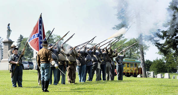The 1st Maryland Infantry Company #1 and the 24th Virginia Cavalry Civil War Re-enactors participate at the annual Rose Hill Memorial Remembrance Program held on Saturday with a volley of gun fire.