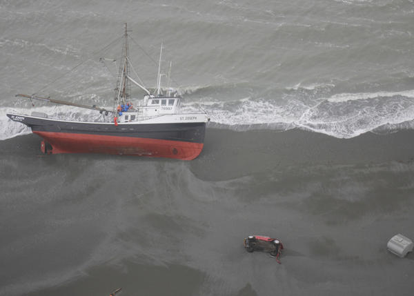 The fishing tender St. Joseph sits grounded on the beach between Yakutat and Kayak Island on the Gulf of Alaska May 26, 2012. The vessel lost steering the previous day in 20-foot seas prompting the Coast Guard to rescue the five-man crew aboard by MH-60 Jayhawk helicopter prior to the grounding.