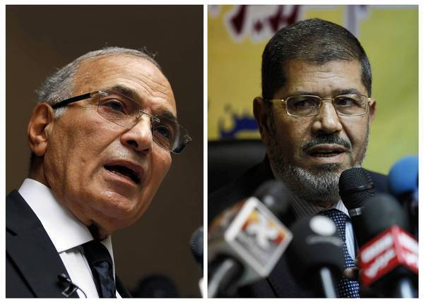 Former Egyptian Prime Minister Ahmed Shafik, left, and Muslim Brotherhood candidate Mohamed Morsi are trying to broaden their appeal for next month's presidential runoff.