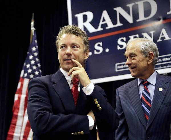 Sen. Rand Paul (R-Ky.), left, with his father, Rep. Ron Paul (R-Texas). A study found the younger Paul's oratory to be at an eighth-grade level.