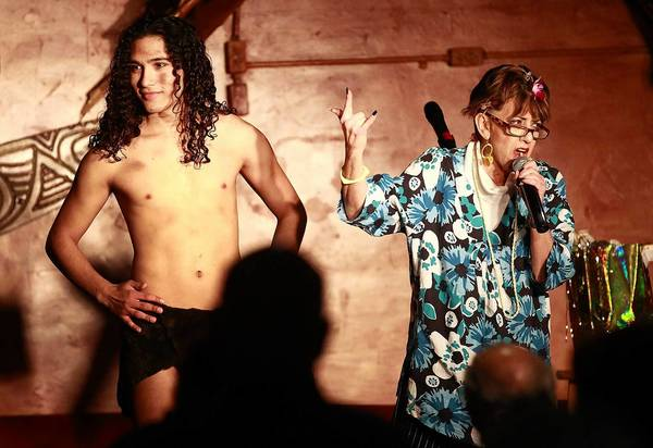 Henrietta Komras, right, and an unidentified Tarzan perform at Bonnie Barchichat's Senior Comedy Afternoon at Don the Beachcomber in Huntington Beach.