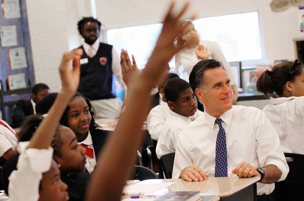 Republican presidential candidate Mitt Romney takes part in a language class at Universal Bluford Charter School in West Philadelphia.