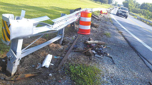 A guardrail at a curve on Md. 66 in Washington County, between U.S. 40 and Benevola Church Road, was replaced after it was hit in a crash. Then, it was hit again. On Thursday, vehicle parts are shown on the ground in various spots along the curve.