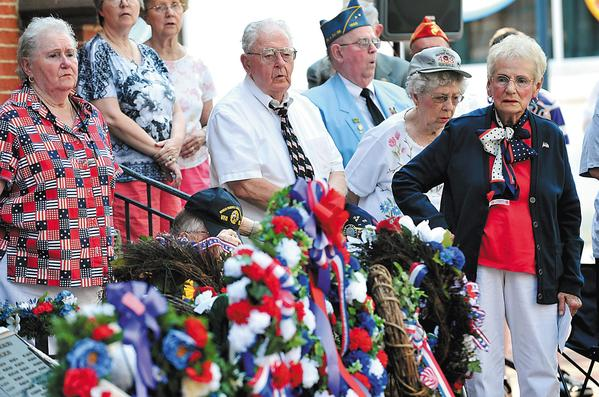 "The crowd sings ""God Bless America"" during the Memorial Day wreath-laying ceremony Sunday at the memorial in front of the Washington County Courthouse in Hagerstown."