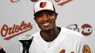 With his six-year, $85.5 million contract extension official, Orioles center fielder <strong>Adam Jones</strong> sat between his two bosses — manager <strong>Buck Showalter</strong> and club executive vice president <strong>Dan Duquette</strong> — on Sunday and said Baltimore is where he belongs.