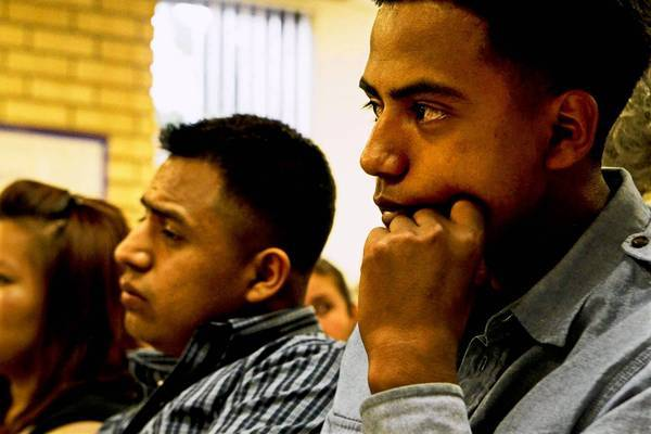 "Abelardo Popec, left, and Romaldo Lopez listen to speakers as indigenous Mexican students and leaders of Ventura County public schools launched the ""No Me Llames Oaxaquita"" (Don't call me little Oaxacan) campaign at the Center for Employment Training in Oxnard."