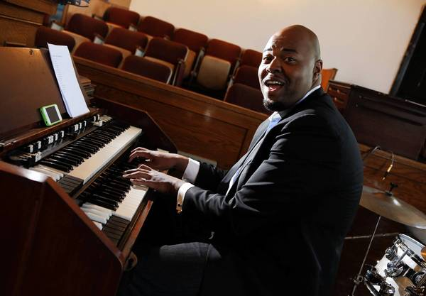 Julian Patterson, the head musician at Taylor Funeral Home, also plays the organ at churches throughout Chicago, including New Exodus Missionary Baptist Church.