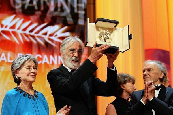 "Austrian director Michael Haneke, center, raises his trophy as he poses with French actors Emmanuelle Riva, left, and Jean-Louis Trintignant after being awarded with the Palme d'Or for his film ""Amour"" during the closing ceremony of the 65th Cannes film festival on May 27."