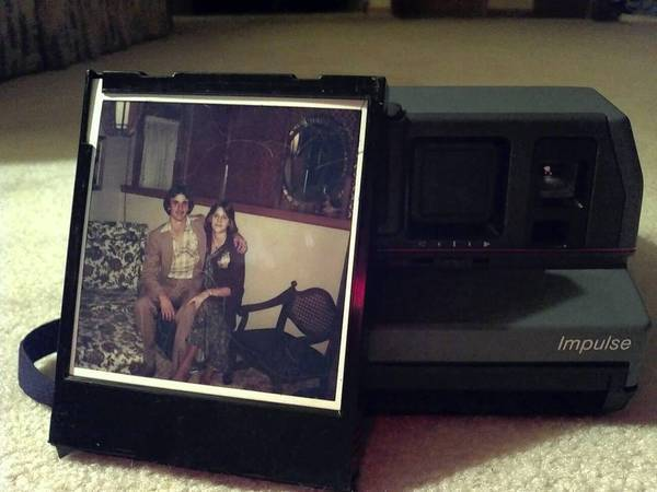 When Addison Logan, 13, opened an old Polaroid camera he bought at a garage sale, he and his grandmother got a big surprise: a picture of her son -- his uncle -- who died 23 years ago. The person with him is possibly a high school girlfriend.