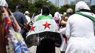 Members of Chicago's Syrian-American community gathered Sunday under a sweltering sun, calling for President Barack Obama to lead the ouster of the Middle Eastern country's ruler, President Bashar Assad.
