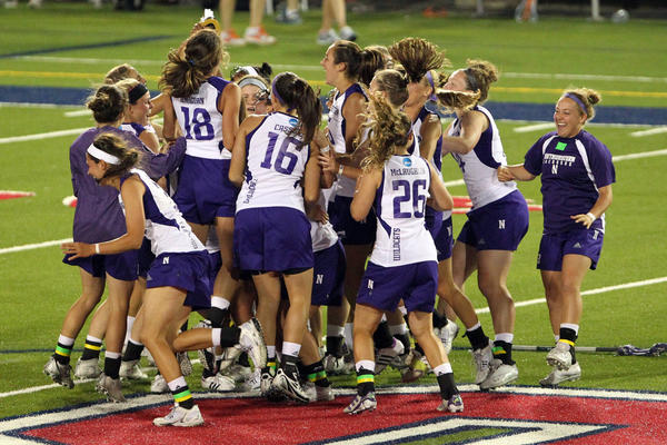The Wildcats celebrate the win against Syracuse.