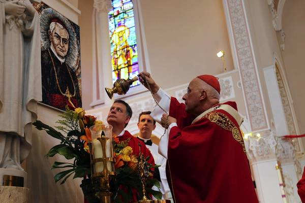 Cardinal Francis George, of Chicago, blesses a mosaic of the late Archbishop George (Jurgis) Matulaitis on the 25th anniversary of Matulaitis' beatification. A service was held Sunday at Nativity of the Blessed Virgin Mary in Chicago's Marquette Park neighborhood.