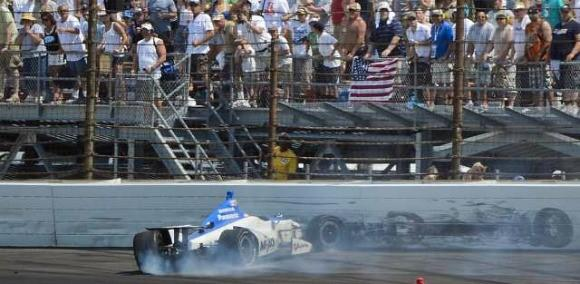 Takuma Sato's car comes to rest against the wall after crashing on the final lap of the Indy 500.