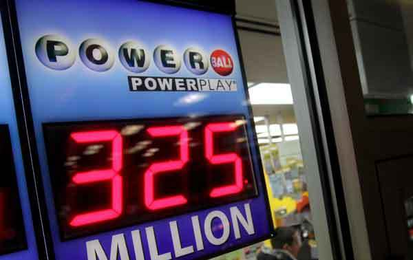 A store's sign advertising Powerball shows a $325 million jackpot in February.