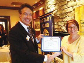 From left, Magnus Dahlgren, president, presents Donna Long with a certificate of membership in the Rotary Club of Long Meadows.
