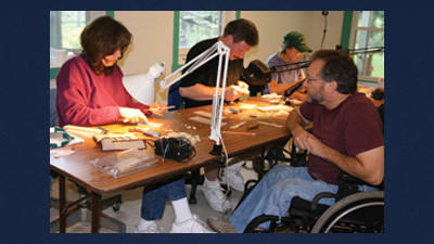 Recently returned from the Ward Foundation World Championships of Bird Carving where he was awarded Best of Show in the Master Class for his sculpture of a nuthatch, sculptor Gary Yoder is seen here teaching a workshop in feather carving at Spruce Forest Artisan Village at Penn Alps. The Artisan Village resident and visiting artists offer one- to three-day workshops in various arts and fine crafts throughout the summer and fall.