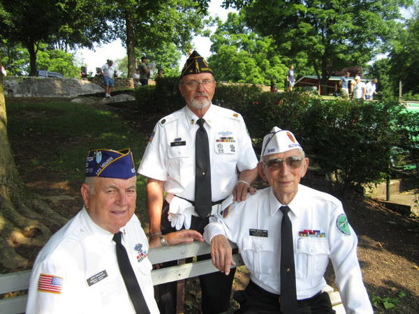 Three veterans at the 2012 Memorial Day ceremony Monday in Martinsburg, W.Va., are from left, John Harmison, seated, Tom Riley and Richard Seeley.
