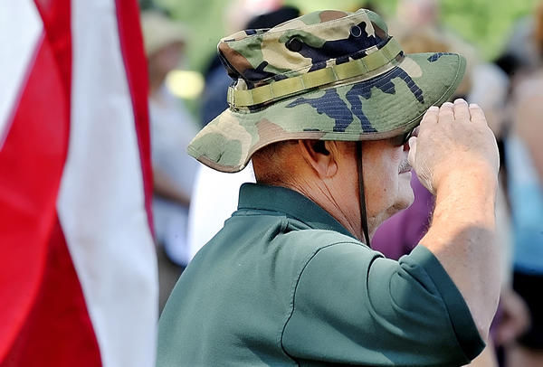 Dick Allen of Falling Waters, W.Va., salutes during the playing of taps Monday at a Memorial Day observance at Rest Haven Cemetery.