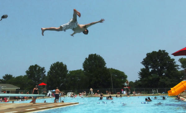 Justin Blum of Williamsport dives into the pool at Marty Snook Memorial Park in Halfway on Monday.