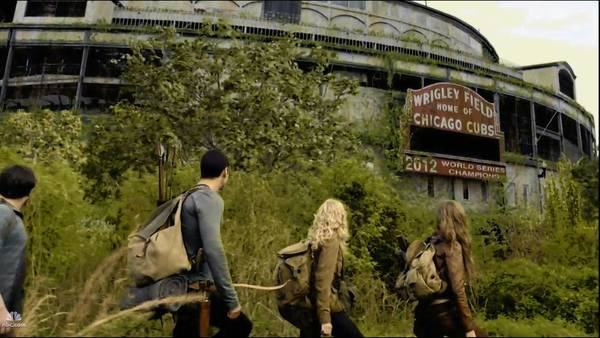 "A scene from the NBC series ""Revolution"" shows Wrigley Field looking rough in the future, but the marquee proclaims that the Cubs won it all in 2012."