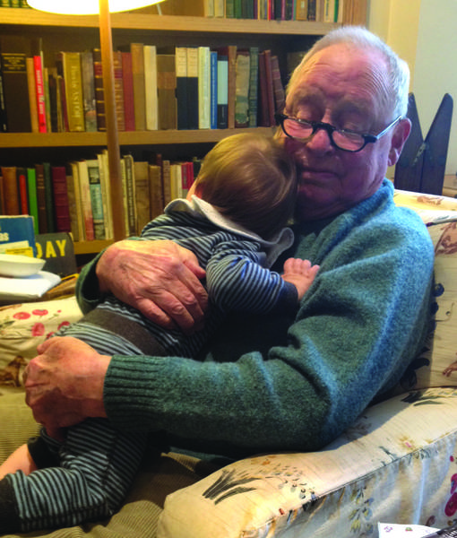Charles C. Haffner III, holding one of his grandsons.