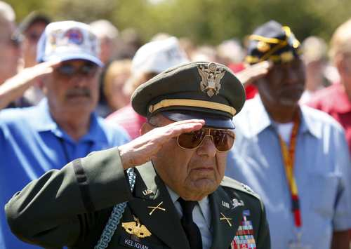 Retired Army Capt. Leo Keligian leads his fellow veterans in the salute to the flag during the Memorial Day observance at Los Angeles National Cemetery in Westwood.