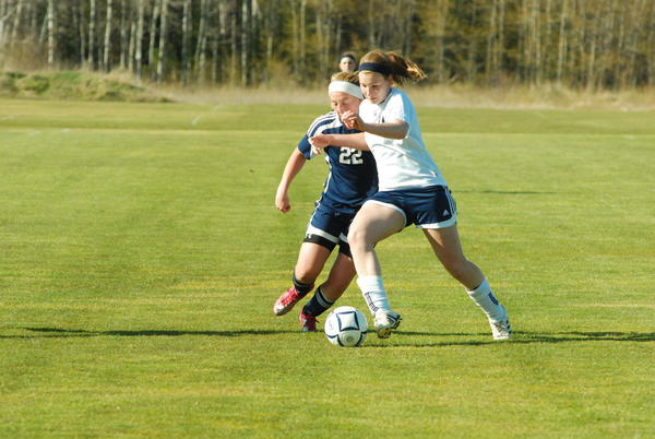 Petoskey junior Alyssa VanWerden fends off a Cadillac player during a 1-0 win earlier this season. The Northmena and Vikings open Division II district play 5 p.m. today, Tuesday, at the Click Road Soccer Complex.