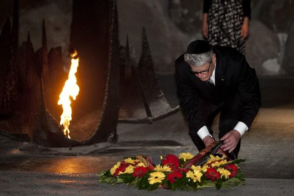 German President Joachim Gauck lays a wreath during a memorial ceremony in the Hall of Remembrance at the Yad Vashem Holocaust memorial on May 29, 2012 in Jerusalem, Israel.