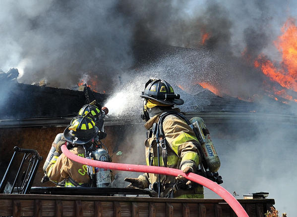 Firefighters get close to the intense heat to battle the blaze from the back deck. A deluge gun was set up from the next street, shooting a large stream of water into the heart of the fire. A neighbor¿s home suffered damage to the siding from the intense heat. Winchester Fire-EMS provided additional manpower. The cause of the fire is under investigation.