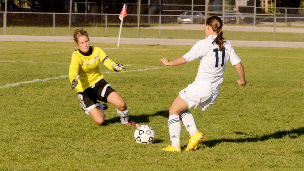 District season is upon us and the Gaylord girls' soccer team opened tournament play Tuesday at Ogemaw Heights. If the Blue Devils prevailed, they will play at the winner of Petoskey and Cadillac Thursday. Here, Gaylord sophomore Maddie Hamilla tries to kick the ball past the Maple City Glen Lake goalkeeper last week.