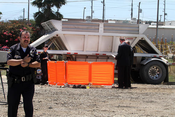 Authorities investigate what police called an accidental death on Monday in Burbank. A man died when he became trapped in the dump truck gates.