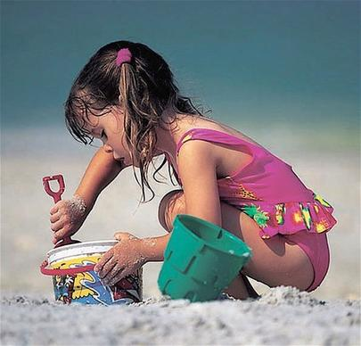 A child plays in the sand on Clearwater Beach.