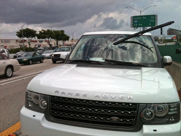 A piece of debris impaled this Range Rover as it was traveling southbound on I-95 near Griffin rd in Hollywood. FDOT Road Ranger Theo Seneck was first on the scene and said both passengers appeared to be unharmed.