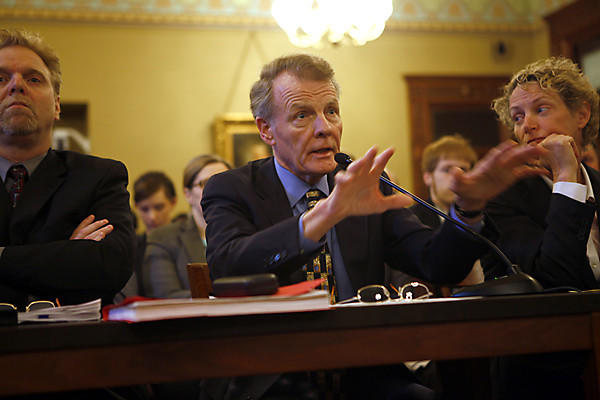 House Speaker Michael Madigan, center, along with his Research and Appropriations Director John Lowder, left, and State Rep. Elaine Nekritz, D-Northbrook, right, presents a state pension reform plan to the House Personnel & Pensions Committee at the Illinois State Capitol in Springfield.