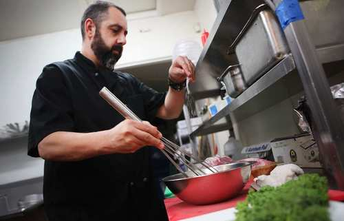 Ricardo Diaz prepares an egg batter for his <i>huazontle</i> dish at his newest restaurant, Bizarra Capital.