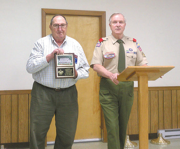 From left, Warren Middlekauff, president of the Chewsville Lions Club, accepts a plaque from Carey Leverett, Troop 62 committee chairman, at the troops recent Court of Honor.