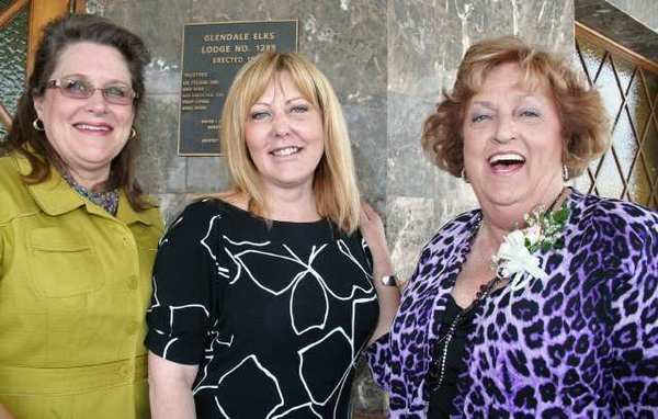 Pretty as a picture in front of the Glendale Elks Lodge are, from left, incoming Womens Civic League President Karin Jonke, speaker Superintendent/President Dawn Lindsay of Glendale Community College and outgoing League President Lynda Burns.
