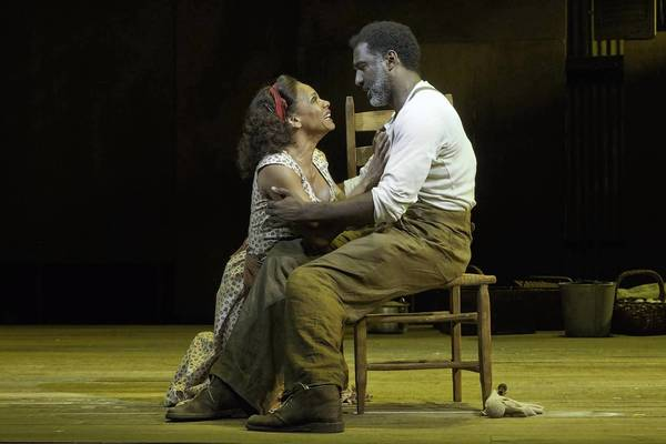 "Audra McDonald, left, and Norm Lewis in a scene from ""The Gershwins' Porgy and Bess."""