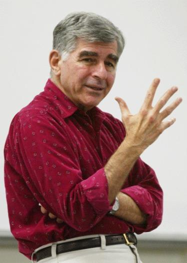 Former presidential candidate and Massachusetts Gov. Michael Dukakis gives a lecture to his graduate school class in the Public Policy Building on the UCLA campus.