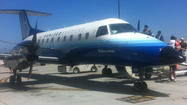SAN DIEGO - A man recently released from jail boarded a flight at San Diego International Airport without a ticket Tuesday morning after getting onto the tarmac through a fire door, according to police.
