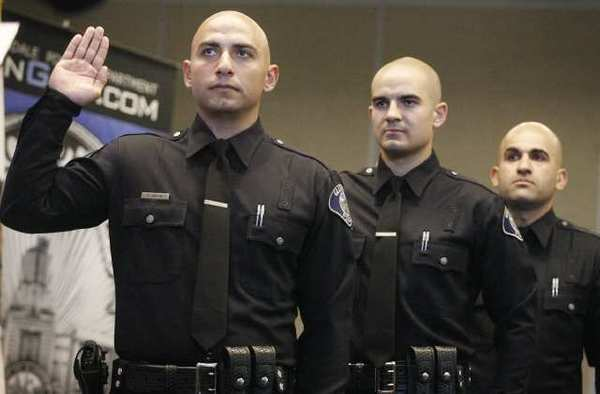 Artin Melik-Kasumyan, from left, Travis Bateman and Eric Voskanian are sworn in during a ceremony at Glendale Police Department.