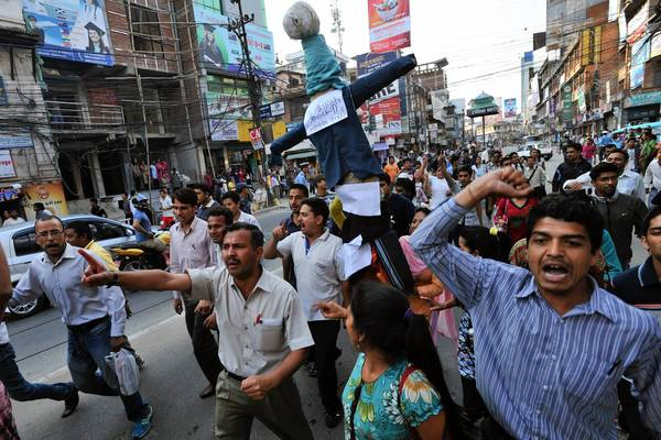 Nepalese demonstrate in Katmandu against ow-caretaker Prime Minister Baburam Bhattarai. The country's leaders missed their deadline over the weekend to write a constitution.