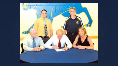 James Otten (seated, center) signs a letter of intent to wrestle at Edinboro University. He is flanked by his parents Brad and Linda Otten and (standing) Shade wrestling coach Ryan Hill and Shade athletic director Mike Pribish.
