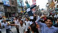 KATMANDU, Nepal — Nepal announced the formation of a caretaker government Tuesday and settled into a tense calm after a weekend constitutional crisis led the prime minister to call elections, some four years and several shaky governments after the country set out to write its crucial, if elusive, national blueprint.