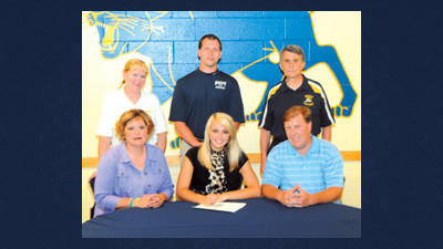 Becca Muha (seated, center) signs a letter of intent to play volleyball at Pitt-Greensburg. She is flanked by her parents Maxine and Andy Muha and (standing) Shade volleyball coach Mindy Leonard, Pitt-Greensburg women's volleyball coach Leroy Simms and Shade athletic director Mike Pribish.